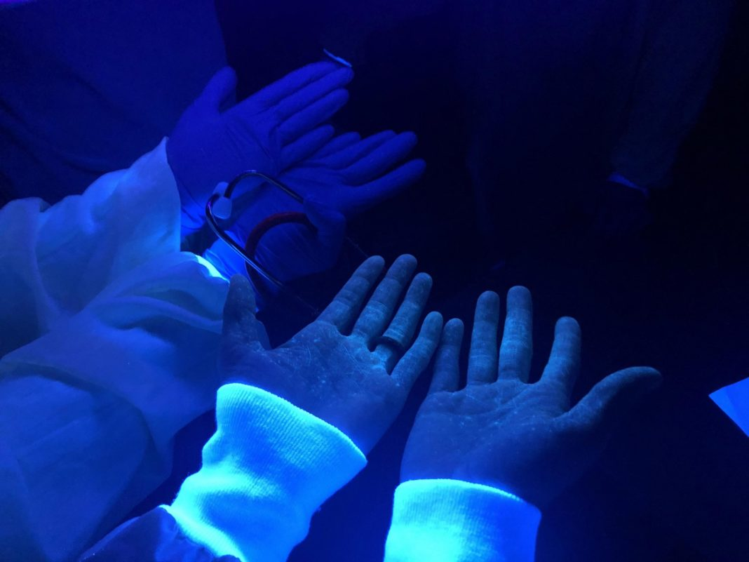 UV Light Exposes Contagion Spread From Improper Personal Protective Equipment Use